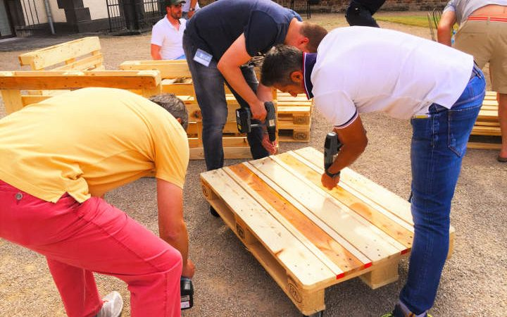 Lounge furniture from wooden pallets self-made brand. The special teambuilding event with a shared sense of achievement!